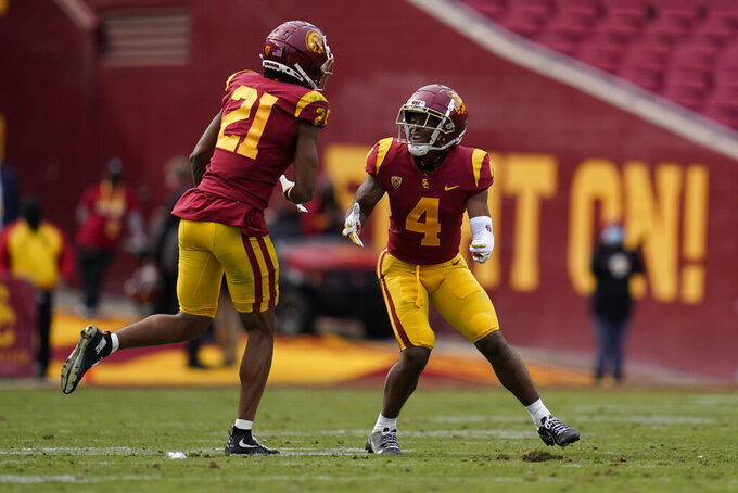 Southern California safeties Isaiah Pola-Mao (21) and Max Williams (4) celebrate after an incomplete pass intended for Arizona State wide receiver LV Bunkley-Shelton (2) during the second half of an NCAA college football game Saturday, Nov. 7, 2020, in Los Angeles. (AP Photo/Ashley Landis)
