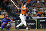 Houston Astros' Kyle Tucker, right, watches his three-run home run hit in front of Texas Rangers catcher Jonah Heim, left, during the third inning of a baseball game Friday, July 23, 2021, in Houston. (AP Photo/Michael Wyke)