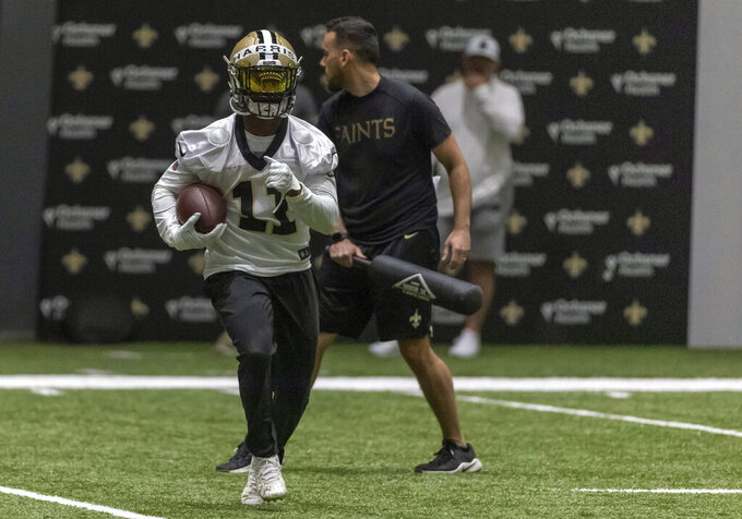New Orleans Saints wide receiver Deonte Harris (11) catches a pass during NFL football training camp in Metairie, Thursday, July 29, 2021. (AP Photo/Derick Hingle)