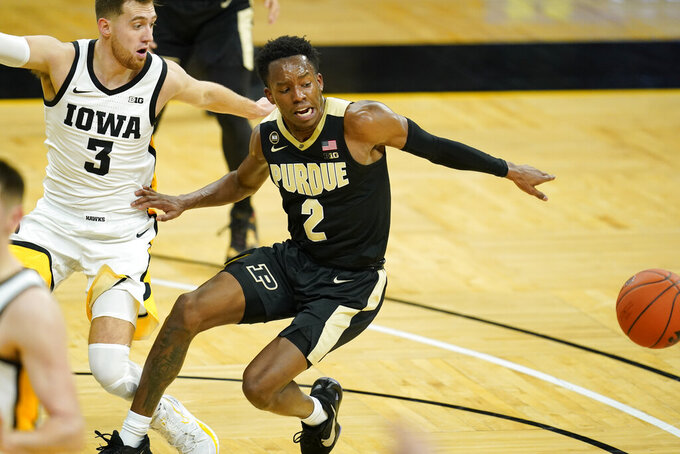 Purdue guard Eric Hunter Jr. (2) fights for a loose ball with Iowa guard Jordan Bohannon (3) during the first half of an NCAA college basketball game, Tuesday, Dec. 22, 2020, in Iowa City, Iowa. (AP Photo/Charlie Neibergall)