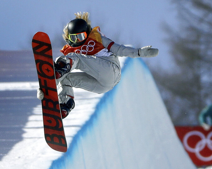 FILE- In this Feb. 13, 2018, file photo, ChloeKim, of the United States, jumps during the women's halfpipe finals at Phoenix Snow Park at the 2018 Winter Olympics in Pyeongchang, South Korea. Chloe Kim took some time off to heal her body and broaden her mind. Mission(s) accomplished, and now that she's back at her day job — best female athlete in the halfpipe — it looks as though she never left. Now 20 and with a year at Princeton under her belt, the Olympic champion is in the lineup for the Winter X Games, going for her fifth gold medal on the superpipe in Aspen on Saturday night, Jan. 30, 2021. (AP Photo/Gregory Bull, File)