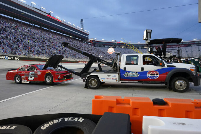 The car of B.J. McLeod (6) is towed into the garage area after a wreck during the NASCAR Xfinity Series auto race Friday, Sept. 18, 2020, in Bristol, Tenn. (AP Photo/Steve Helber)