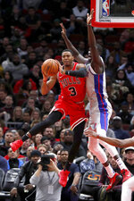 Chicago Bulls' Shaquille Harrison, left, looks to pass under pressure from Detroit Pistons' Thon Maker, right, during the first half of an NBA basketball game Wednesday, Nov. 20, 2019, in Chicago. (AP Photo/Charles Rex Arbogast)