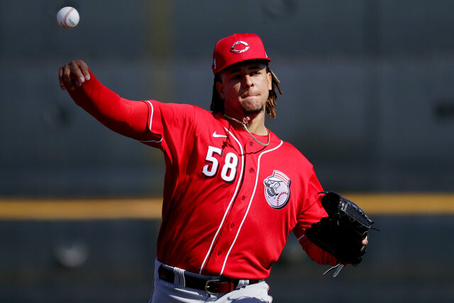 Cincinnati Reds baseball player Luis Castillo (58) works out during the teams' first spring training practice, Saturday, Feb. 15, 2020, in Goodyear, Ariz. (AP Photo/Matt York)