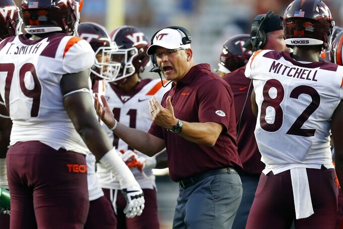 Virginia Tech head coach Justin Fuente talks to his team during the second half of an NCAA college football game against Boston College in Boston, Saturday, Aug. 31, 2019. (AP Photo/Michael Dwyer)