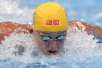 Sarah Sjoestroem of Sweden swims in the final of the women's 100-meter butterfly at the 2020 Summer Olympics, Monday, July 26, 2021, in Tokyo, Japan. (AP Photo/Matthias Schrader)