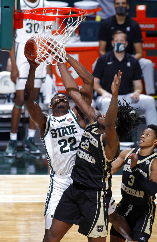 Michigan State's Mady Sissoko, left, shoots against Western Michigan's Titus Wright, center, and B. Artis White, right, during the second half of an NCAA college basketball game, Sunday, Dec. 6, 2020, in East Lansing, Mich. (AP Photo/Al Goldis)