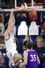 Gonzaga forward Drew Timme, left, dunks next to Northwestern State forward Dalin Williams during the first half of an NCAA college basketball game in Spokane, Wash., Monday, Dec. 21, 2020. (AP Photo/Young Kwak)