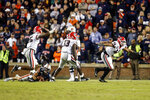 Georgia defensive lineman Travon Walker (44) celebrates after sacking Auburn quarterback Bo Nix (10) to secure the 21-14 win in the second half of an NCAA college football game, Saturday, Nov. 16, 2019, in Auburn, Ala. (AP Photo/Butch Dill)
