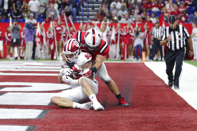 Penix helps Hoosiers hold on for 34-24 victory over Ball St.