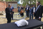 """Warsaw's Jewish community held a funeral for an unidentified Holocaust victim after human remains were recently discovered in an area that belonged to the Warsaw Ghetto during World War II, in Warsaw, Poland, Tuesday Sept. 14, 2021. The remains were buried in Warsaw's Jewish Cemetery, with the country's chief rabbi saying, """"We are here as the family for a person we don't know."""" (AP Photo/Vanessa Gera)"""