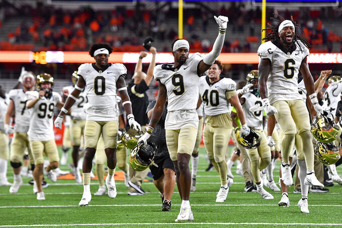 Wake Forest wide receiver A.T. Perry (9) reacts after his touchdown in overtime was confirmed in an NCAA college football game against Syracuse in Syracuse, N.Y., Saturday, Oct. 9, 2021. Wake Forest won 40-37. (AP Photo/Adrian Kraus)