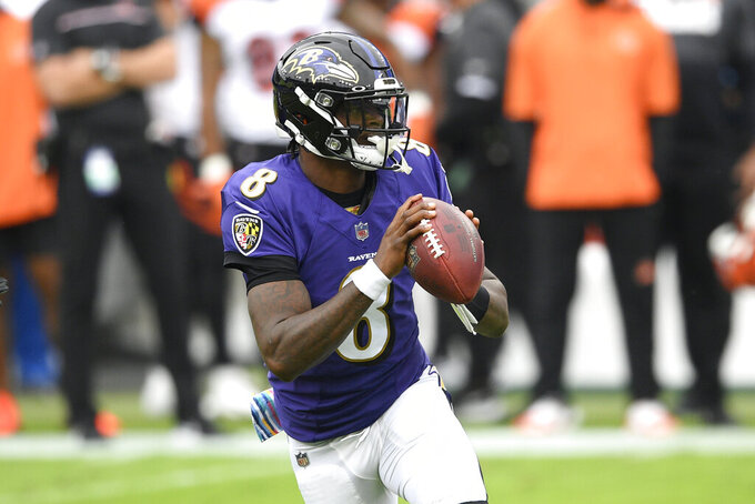 Baltimore Ravens quarterback Lamar Jackson looks to pass against the Cincinnati Bengals during the first half of an NFL football game, Sunday, Oct. 11, 2020, in Baltimore. (AP Photo/Nick Wass)