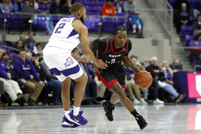 TCU guard Edric Dennis (2) defends as Louisiana-Lafayette guard Cedric Russell (0) drives to the basket during the first half of an NCAA college basketball game in Fort Worth, Texas, Tuesday, Nov. 12, 2019. (AP Photo/Tony Gutierrez)