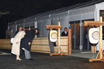 Japanese Prime Minister Shinzo Abe and his wife Akie Abe bow in front of the main gate of Daijo hall to attend a ceremony for Emperor Naruhito in Tokyo Thursday, Nov. 14, 2019. Emperor Naruhito performed a secretive and controversial ritual Daijosai Thursday, a once-in-a-reign event to give thanks for good harvests, pray for the peace and safety of the nation and play host to his family's ancestral gods. (Hiroko Harima/Kyodo News via AP)