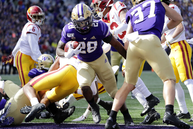 Washington's Richard Newton (28) scores on a one-yard run against Southern Cal in the first half of an NCAA college football game Saturday, Sept. 28, 2019, in Seattle. (AP Photo/Elaine Thompson)