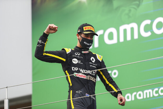 Renault driver Daniel Ricciardo of Australia celebrates on the podium after he placed third in the Eifel Formula One Grand Prix at the Nuerburgring racetrack in Nuerburg, Germany, Sunday, Oct. 11, 2020. (AP Photo/Matthias Schrader, Pool)