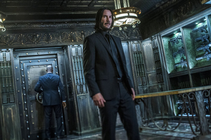 This image released by Lionsgate shows Keanu Reeves in a scene from