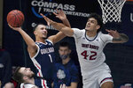 Gonzaga guard Jalen Suggs (1) shoots against Saint Mary's forward Dan Fotu (42) during the second half of an NCAA college basketball game in Moraga, Calif., Saturday, Jan. 16, 2021. (AP Photo/Jeff Chiu)