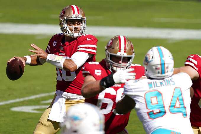 San Francisco 49ers quarterback Jimmy Garoppolo (10) passes against the Miami Dolphins during the first half of an NFL football game in Santa Clara, Calif., Sunday, Oct. 11, 2020. (AP Photo/Tony Avelar)