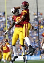 Southern California 's Amon-Ra St. Brown (8) celebrates his touchdown reception with teammate Michael Pittman Jr. during the first half of an NCAA college football game against UCLA, Saturday, Nov. 17, 2018, in Pasadena, Calif. (AP Photo/Marcio Jose Sanchez)