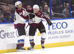 Colorado Avalanche defenseman Samuel Girard (49) and center Tyson Jost (17) celebrate Jost's third goal of the night during the second period of an NHL hockey game against the Tampa Bay Lightning Saturday, Oct. 19, 2019, in Tampa, Fla. (AP Photo/Jason Behnken)