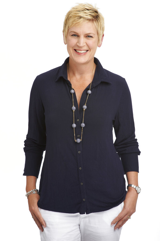 This undated photo provided by NBC shows Molly Solomon.  Molly Solomon began her career at NBC Sports as a researcher for its Olympics coverage. Nearly 30 years later, she will lead its coverage. NBC announced on Tuesday, Nov. 19, 2019, that it has promoted Solomon to executive producer and president of the network's Olympics unit, becoming the first woman to be an executive producer for a network sports division. (Virginia Sherwood/NBC via AP)
