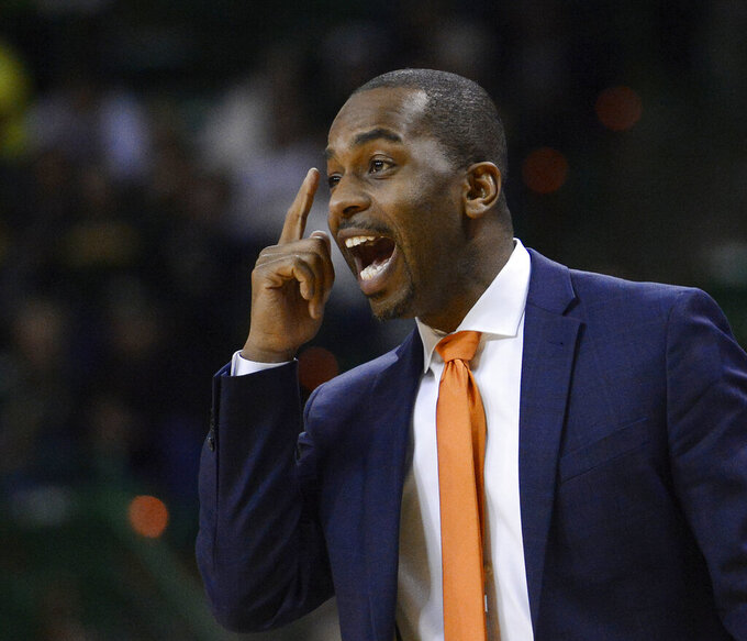 Oklahoma State coach Mike Boynton yells out a play against Baylor during the second half of an NCAA college basketball game Wednesday, March 6, 2019, in Waco, Texas. (Ernesto Garcia/Waco Tribune Herald via AP)
