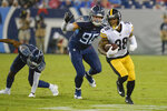Pittsburgh Steelers running back Jaylen Samuels (38) runs past Tennessee Titans defensive end Brent Urban (96) in the first half of a preseason NFL football game Sunday, Aug. 25, 2019, in Nashville, Tenn. (AP Photo/Mark Zaleski)