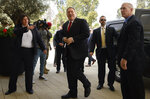 US Secretary of State Mike Pompeo, center, arrives for a meeting with Ethiopian Prime Minister Abiy Ahmed at the Prime Minister's office in Addis Ababa, Tuesday Feb. 18, 2020. Pompeo's visit to Africa is the first by a Cabinet official in 18 months. (Andrew Caballero-Reynolds/Pool via AP)