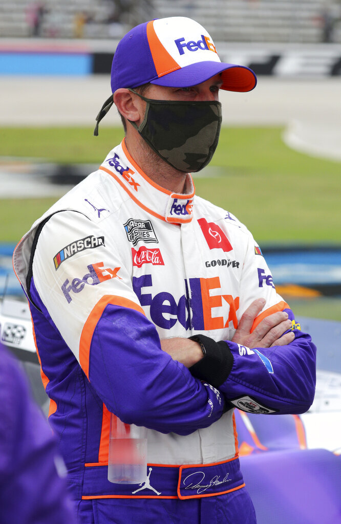 Denny Hamlin (11) waits on the grid before a NASCAR Cup Series auto race at Texas Motor Speedway in Fort Worth, Texas, Sunday, Oct. 25, 2020. (AP Photo/Richard W. Rodriguez)
