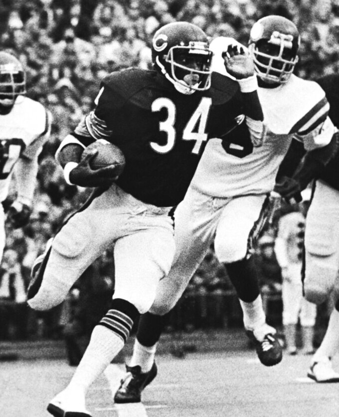FILE - In this Nov. 20, 1977, file photo, Chicago Bears' Walter Payton (34) runs for three yards in first quarter of an NFL football game against the Minnesota Vikings in Chicago. Sweetness ran for 275 yards, a single-game record. (AP Photo/Fred Jewell, File_