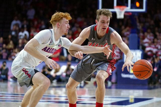 Utah guard Jaxon Brenchley (5) gets pressured by Arizona guard Nico Mannion during the first half of an NCAA college basketball game Thursday, Jan. 16, 2020, in Tucson, Ariz. (AP Photo/Rick Scuteri)