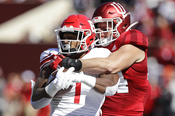 Rutgers running back Isaih Pacheco is tackled by Indiana linebacker Thomas Allen (44) during the first half of an NCAA college football game, Saturday, Oct. 12, 2019, in Bloomington, Ind. (AP Photo/Darron Cummings)