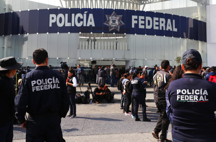 Striking police continue to hold a federal police command center in the Iztapalapa borough, in Mexico City, Thursday, July 4, 2019, to protest against plans to force them into the newly formed National Guard. On Wednesday, federal police held the command center and blocked key highways around the capital. They expressed concerns about potentially losing their salaries, benefits and seniority if they transferred to the National Guard and being left unemployed if they don't join the new force. (AP Photo/Marco Ugarte)