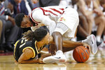 Southern Mississippi guard Auston Leslie fights for a loose ball with Iowa State guard Tre Jackson, right, during the second half of an NCAA college basketball game, Tuesday, Nov. 19, 2019, in Ames, Iowa. Iowa State won 73-45. (AP Photo/Charlie Neibergall)