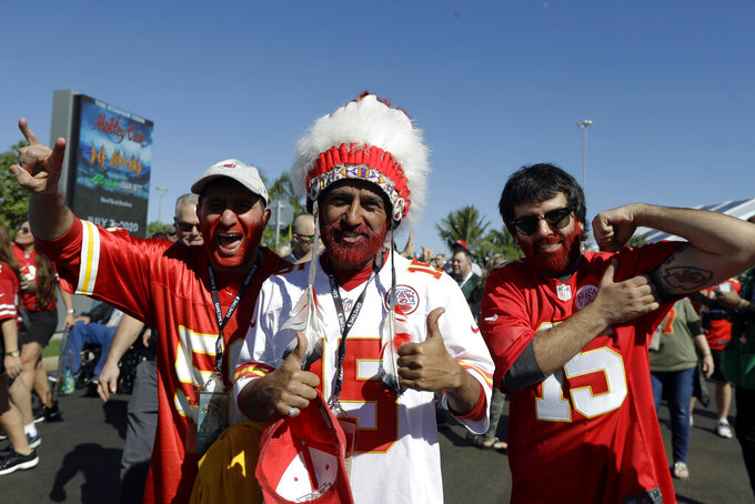 FILE - In this Feb. 2, 2020 file photo, Kansas City Chiefs fans arrive for the NFL Super Bowl 54 football game between the Chiefs and the San Francisco 49ers, in Miami Gardens, Fla. The Kansas City Chiefs fans who file into Arrowhead stadium Thursday, Sept. 10, 2020 for a masked and socially distanced start to the current season won't be wearing headdresses or face paint amid a nationwide push for racial justice following the death of George Floyd in Minneapolis. (AP Photo/Chris O'Meara File)