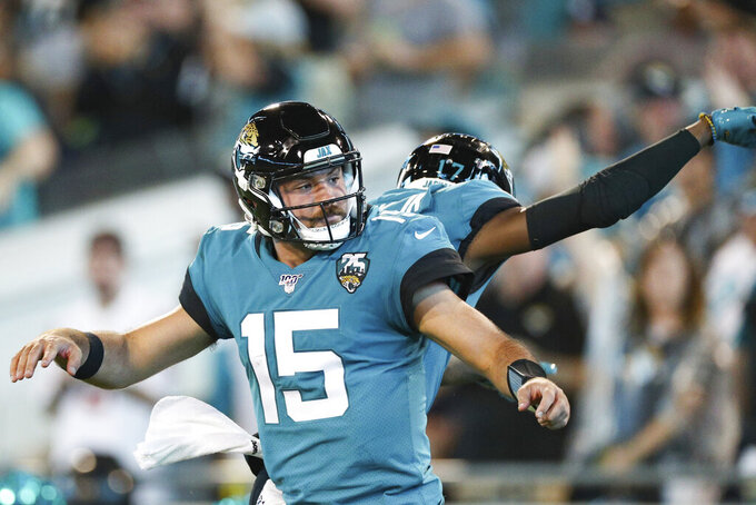 Jacksonville Jaguars quarterback Gardner Minshew (15) celebrates a touchdown in an NFL game against the Tennessee Titans, Thursday, Sept. 19, 2019, in Jacksonville, Fla. The Jaguars defeated the Titans 20-7. (Margaret Bowles via AP)