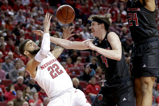 Nebraska's Haanif Cheatham (22) is fouled by Rutgers' Paul Mulcahy (4) during the first half of an NCAA college basketball game in Lincoln, Neb., Friday, Jan. 3, 2020. (AP Photo/Nati Harnik)