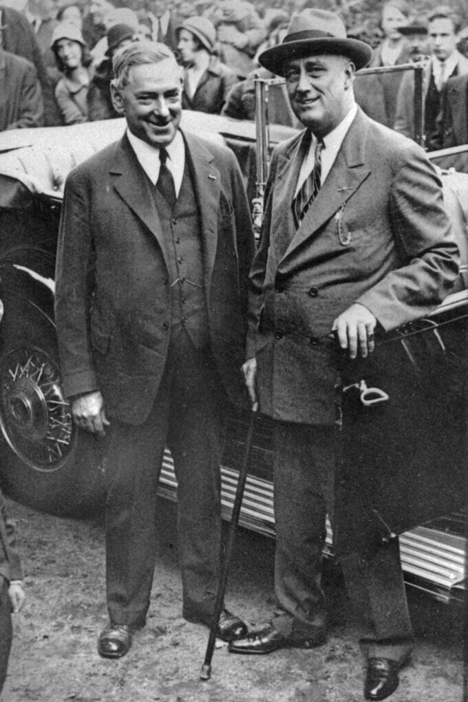 FILE - In this Oct. 30, 1932 file photo, Boston Mayor James M. Curley, left, stands with then-Democratic presidential candidate Franklin D. Roosevelt during a presidential campaign stop in Groton, Mass. Curley, the real-life Irish-American city boss, was elected mayor four times between 1914 and 1946. Boston is facing a historic political pivot with the expected departure of Mayor Marty Walsh to become President Joe Biden's labor secretary. (AP Photo, File)