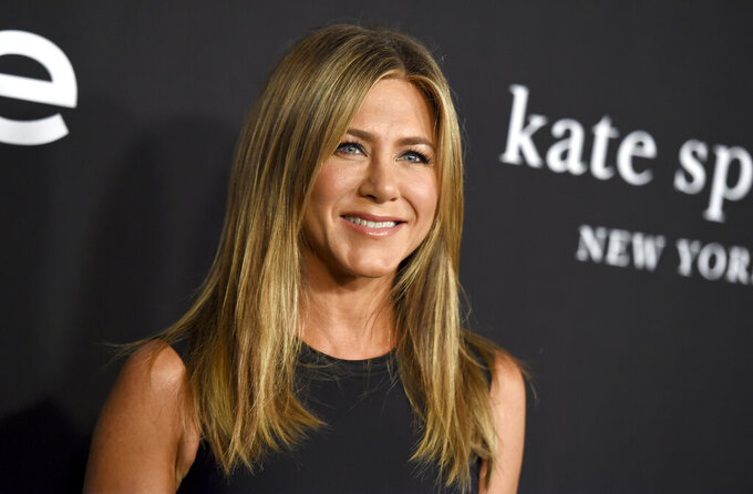 "FILE - Jennifer Aniston arrives at the fourth annual InStyle Awards on Oct. 22, 2018, in Los Angeles. Aniston is among the celebrities taking part in an Aug. 20 virtual reading of the script for 1982's ""Fast Times at Ridgemont High"" as an online fundraiser. (Photo by Jordan Strauss/Invision/AP, File)"