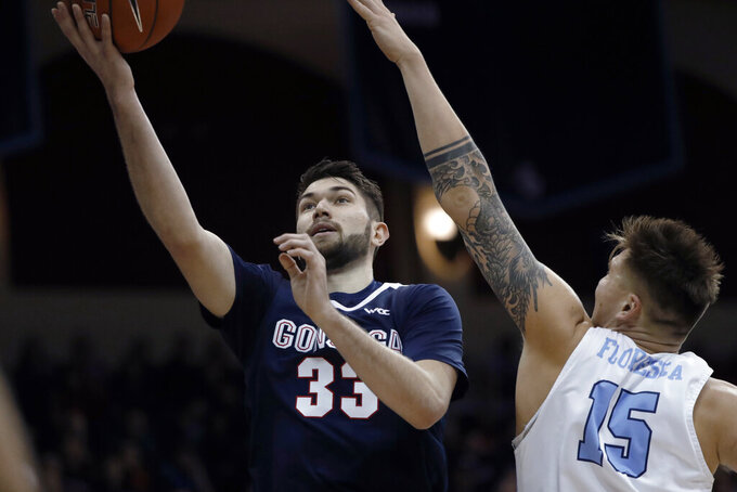Gonzaga forward Killian Tillie (33) shoots as San Diego forward Alex Floresca (15) defends during the first half of an NCAA college basketball game Thursday, Jan. 9, 2020, in San Diego. (AP Photo/Gregory Bull)