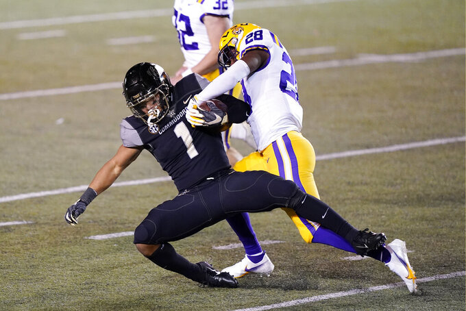Vanderbilt's Donovan Kaufman (1) is brought down by LSU's Nick Rocha (28) on a kickoff return in the first half of an NCAA college football game Saturday, Oct. 3, 2020, in Nashville, Tenn. (AP Photo/Mark Humphrey)
