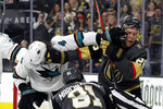 San Jose Sharks defenseman Brenden Dillon (4) and Vegas Golden Knights center Paul Stastny (26) trade punches during the second period of Game 3 of an NHL first-round hockey playoff series game, Sunday, April 14, 2019, in Las Vegas. (AP Photo/Isaac Brekken)