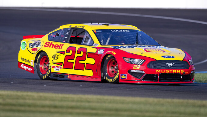 Joey Logano (22) during qualifying for a NASCAR Cup Series auto race at Indianapolis Motor Speedway, Sunday, Aug. 15, 2021, in Indianapolis. (AP Photo/Doug McSchooler)