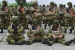 Russian paratroopers wait to be load into a plane for airborne drills during maneuvers in Taganrog, Russia, Thursday, April 22, 2021. Russia's defense minister on Thursday ordered troops back to their permanent bases following massive drills amid tensions with Ukraine, but said that they should leave their weapons behind in western Russia for another exercise later this year. (AP Photo)