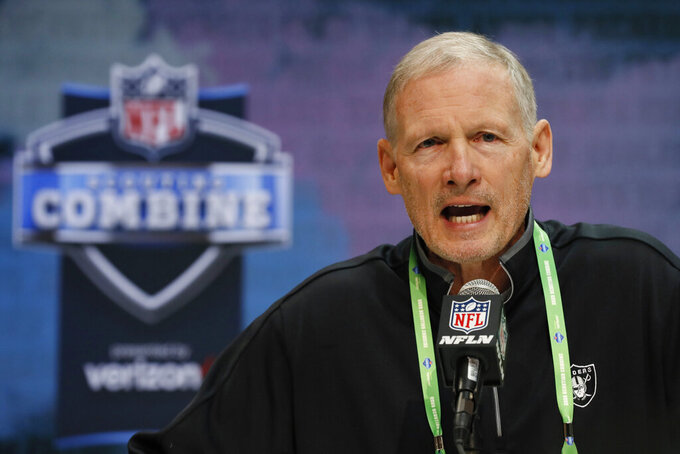 FILE - In this Feb. 25, 2020, file photo, Las Vegas Raiders general manager Mike Mayock speaks during a news conference at the NFL football scouting combine in Indianapolis. The NFL Draft is April 23-25. (AP Photo/Charlie Neibergall, File)