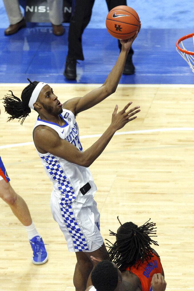 Kentucky's Isaiah Jackson, top, shoots near Florida's Anthony Duruji during the second half of an NCAA college basketball game in Lexington, Ky., Saturday, Feb. 27, 2021. (AP Photo/James Crisp)