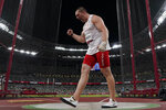 Wojciech Nowicki, of Poland, competes in the final of the men's hammer throw at the 2020 Summer Olympics, Wednesday, Aug. 4, 2021, in Tokyo. (AP Photo/David J. Phillip)