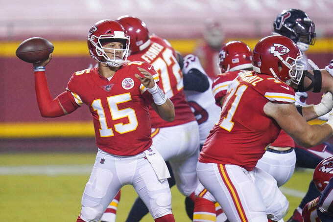 Kansas City Chiefs quarterback Patrick Mahomes (15) passes against the Houston Texans in the first half of an NFL football game Thursday, Sept. 10, 2020, in Kansas City, Mo. (AP Photo/Jeff Roberson)